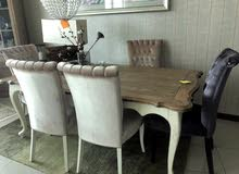 A dining table with 5 chairs