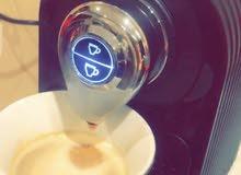 ألة كبسولات القهوة لتحضير اسرع وألذ فنجان قهوة بضغطت زر مع ستاندات للكبسولات