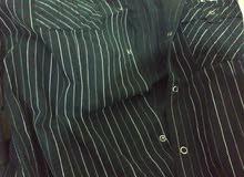قميص اسود.مخطط ابيض جديد