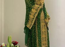 ثوب نشل اخضر مع ذهبي