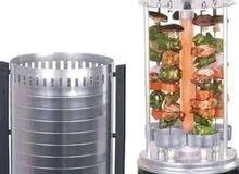شواية عامودية كهربائية بقوة 1000 واط (6) سياخ دوارة سهلة ومريحة تعمل على تدوير