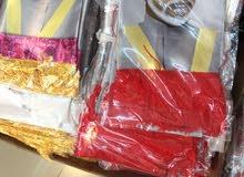 ميداليات ساعات محفظات ملابس شالات كلها بمناسبة العيد الوطني