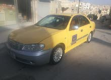 Yellow Nissan 100NX 2010 for sale