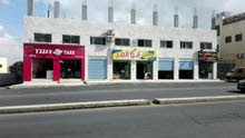 محلات تجارية في موقع متميز ومستودع كبير للايجار في طبربور