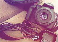 كاميره canon D1200 عدسه 50mm