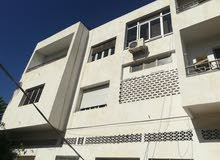 للبيع عمارة من 16 شقة و محلات تجارية وسط مدينة أغادير بجوار ساحة الامل و شارع الحسن الثاني .