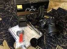 Nikon D3100 DIGITAL SLR CAMERA with AF-S DX VR 18-55mm LENS