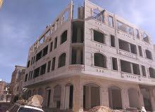 عمارة بدروم واربعة ادوار شارعين في افضل احياء العاصمة قرب شارع الجزائر
