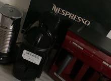 صانعة القهوة جديدة الإستعمال من نسبريسو مع خافقة الحليب