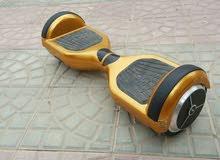 اسكوتر ذكي لون ذهبي مستخدم ثلاثه أشهر حجم كبير