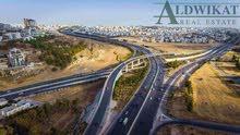 ارض للبيع في اجمل مناطق طريق المطار (خربة سكا) , مساحة الارض 911م