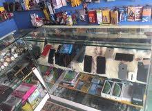 محل تلفونات واكسسوارات للبيع