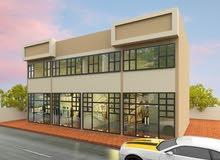 مبني محلات تجارية في عجمان منطقة الياسمين علي شارع الزبير مباشرة مقابل الرحمانية