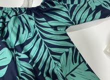 قميص اخضر وازرق ينفع للبحر شريته ومالبسته