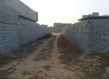 قطعة ارض للبيع بمنطقة كرزاز مساحتها 2650م2 تبعد عن الطريق الساحلي اقل من كيلو م