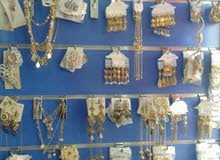 Jewelry set rings ear rings bangles scaf clifs are all items of artificial jewel