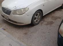 سيارة هونداي افانتي 2008 منفوخة ابيض اللون كتينة حديد