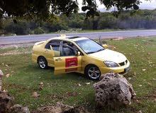 Automatic Yellow Mitsubishi 2010 for sale