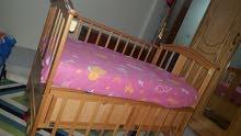 سرير اطفال ثابت وهزاز