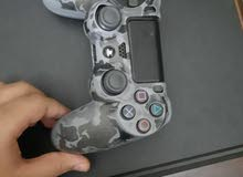 play station 4 slim + controller في حاله جيده جدا