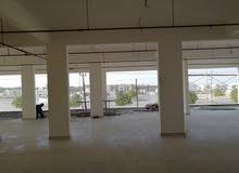 مبنى تجاري ولاية الرستاق امام المجمع الرياضي