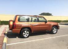 Orange Nissan Patrol 2009 for sale