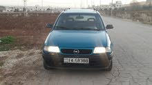 Turquoise Opel Astra 1992 for rent