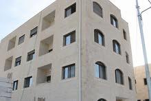 شقة للبيع في منطقة  ( خريبة السوق ) مساحة 100 متر طابق أول _ منطقة مخدومة