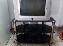 تلفزيون مع طاوله شغال 100%
