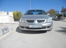 For sale 2009 Grey Lancer