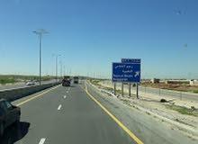 ارض للبيع ملاصقة لشارع ممر عمان التنموي ( شارع الميه ) الموقر - رجم الشامي