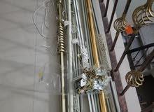 مجموعة من اعمدة الستائر واكسسوارتها الكل ب 40 درهم للكل
