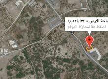 أرض سكني تجاري  في صحار للبيع خط اول شارع النزهه