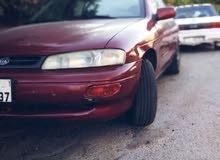 For sale 1995 Maroon Sephia