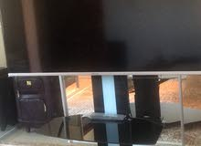 hisense 65inch tv with ceramic table included, used but in great condition for sale