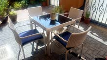 Home center Rattan white garden table + 4 chairs with tempered glass top