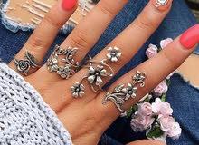 Women flowers ring set. طقم خواتم الورود