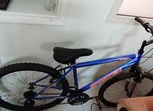 Blue bicycle for sale دراجة للبيع مع خوذة