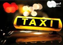 سائق تاكسي توصيل طلبه للمدارس كحلي وبيضاء في طرابلس