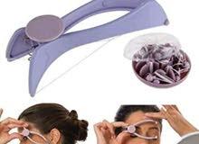 جهاز إزالة الشعر بالخيط.