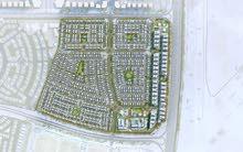 للبيع في دبي أراضي سكنية في دبي لاند (فلل) الموقع شارع الامارات بجانب مشروع الحبتور للبولو ذا فيلا