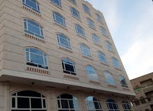 عماره كبيره جدا عدد الطوابق موضح في الصور مع دور ارضي تنفع مستشفى