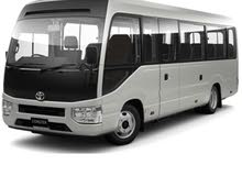 White Toyota Coaster 2018 for rent