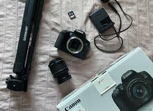 كاميرا كانون 850D + عدسة + ترايبود + ميموري كارد