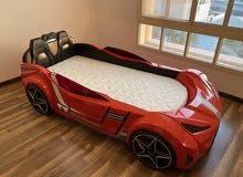 سرير أطفال بشكل سيارة سباق مع اضاءة وسماعات