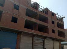برج مرخص  شقة تمليك واجهه علي شارع 30 متر  خطوات من أولاد رجب اللبيني المريوطيه