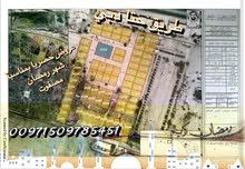 (مصفوت) . تملمك اراضي سكنية علي شارع حتا عمان بسعر (94) الف درهم شامل كل شي