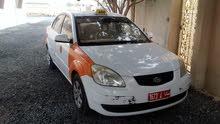 للبيع تكسي مع الرقم كيا ريو موديل 2009