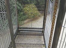 قفص حديد كبير متحرك على عجلات {تفصيل}  مع جرار أسفل القاعدة  قياس 110×110×75