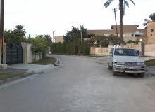 ارض سكنية حي الجامعة بالقرب من شارع الربيع ونفق الشرطة